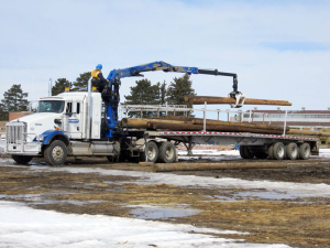 Adams Industries Loading Wood On Truck Trailer