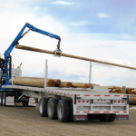 Adams-industries-truck-loading-wood-logs-our-company
